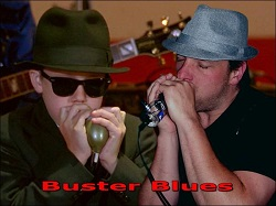 Blues harmonica player with Bottle 'O Blues microphone